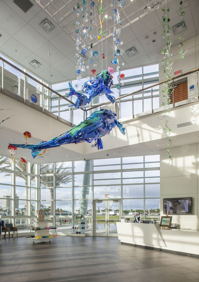 "A double-height lobby and gift shop space feature a permanent art installation by artist Sayaka Ganz.  The sculpture, entitled ""Embrace,"" is comprised of reclaimed trash and recycling gathered from nearby beaches."