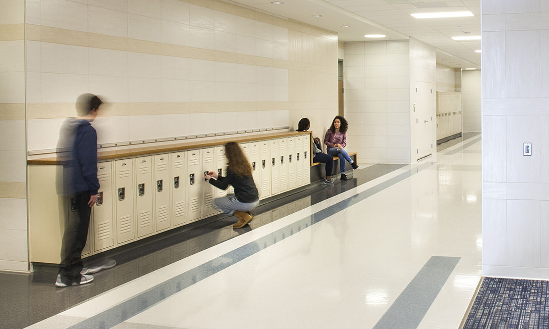 Hot Spots: Benches and high countertops in the corridors provide spaces for a quick chat or plug-in between class.