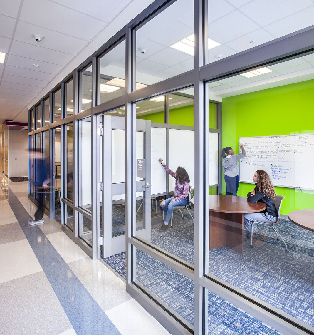 Think Tanks: Enclosed, but still visible spaces that support mixed-learning between departments, small group discussions, and group work.  Located in the academic corridors, these spaces are open to all departments and can accommodate up to 8 people.
