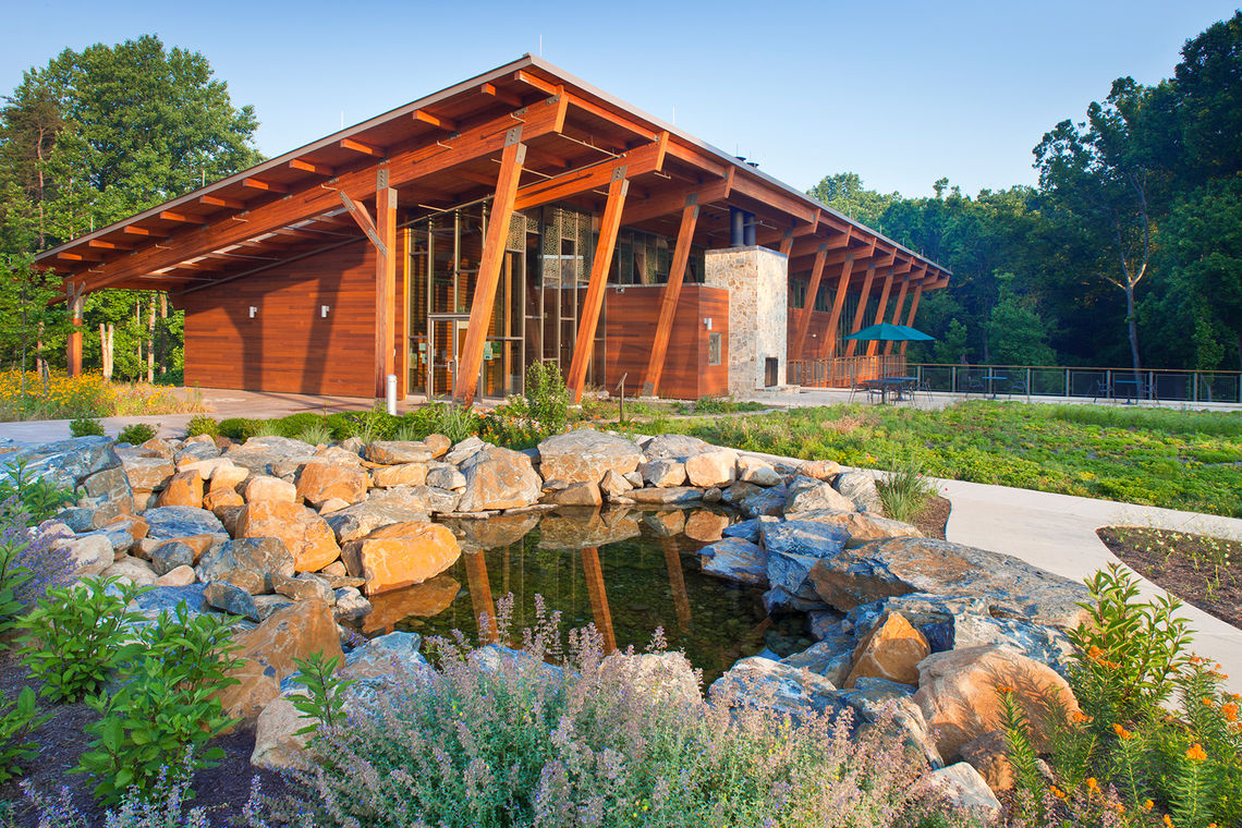 Visitors to the Robinson Nature Center are immediately afforded a view of the center and a clear directional understanding as they enter the site and turn into the parking lot.