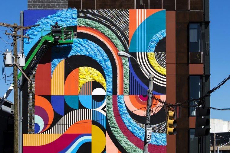 MICA Films Video of Mural Installation at Dolphin Design Center